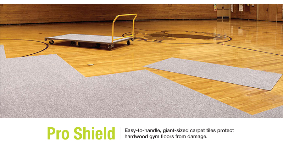 The Next Level Sports Group. Pro Shield gym floor carpet tiles. Easy-to-handle, giant-sized carpet tiles protect hardwood gym floors from damage.